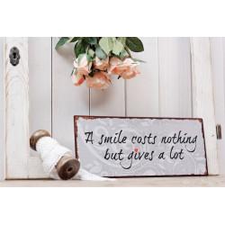 """Metallschild """"A smile gives a lot"""""""